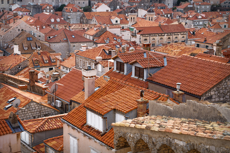 Detail of the orange ancient roofs of Dubrovnik shined by sunslight, Croatia Stock Photo