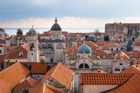 View over the orange roofs of old town Dubrovnik with church towers and ocean in winter, Croatia Stock Photo