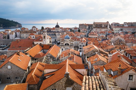 View over the roofs of old town Dubrovnik with church towers and ocean in winter, Croatia