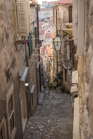 Narrow medieval alley with downstairs view in Dubrovnik in winter, Croatia
