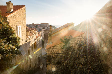View over the orange roofs of Dubrovnik with the last winter sun and lens flare, Croatia Stock Photo