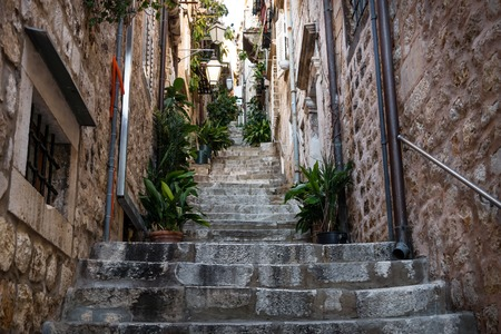 Narrow medieval alley with stairs upin Dubrovnik in winter, Croatia Stock Photo