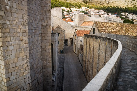 Entrance of the fort of Dubrovnik with cobbled street seen from the upper wall, Croatia