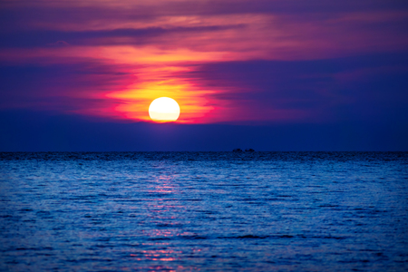 Red Purple sunset into the ocean with two ships in the horizont, Koh Rong Sanloem, Cambodia, Asia