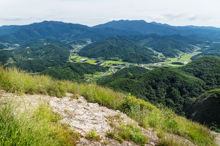 View into the valley with fields and hills from the top of Maisan mountain, horse ear mountain, Maryeong-myeon, South Korea Stock Photo - 118920843