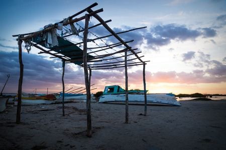 Abandoned hut at the lagoon of Chelem during sunset with purple sky, Mexico