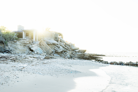Abandoned house during sunset at the beach in Chelem, Mexico Stock Photo