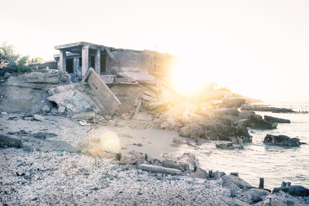 Abandoned house during sunset with backlight at the beach in Chelem, Mexico Stock Photo