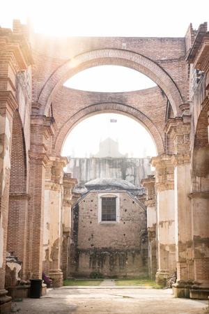 Ruins of Templo de San Jose cathedral with sun backlight, Antigua, Guatemala, Central America