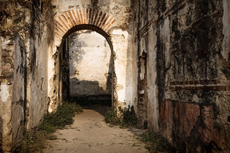 Sun lightened abandoned arch in ruins of Templo de San Jose cathedral, Antigua, Guatemala, Central America