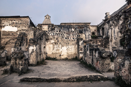 Backyard in ruins of Templo de San Jose cathedral with blue cloudscape, Antigua, Guatemala, Central America
