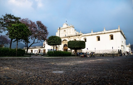 San Jose cathedral on Plaza Mayor square with dramatic blue cloudscape in Antigua, Guatemala
