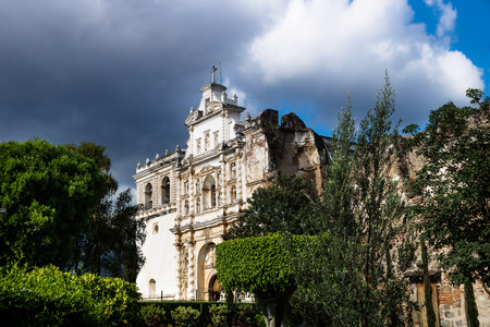 Church of San Fransisco el Grande with dramatic sky with sunshine, Antigua, Guatemala