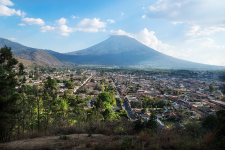 View over Antigua from Cerro de la Cruz with volcano, Antigua, Guatemala