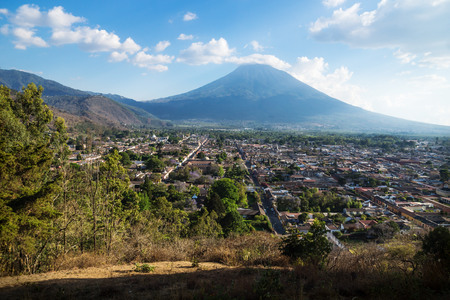 Sunny view over Antigua from Cerro de la Cruz with volcano, Antigua, Guatemala