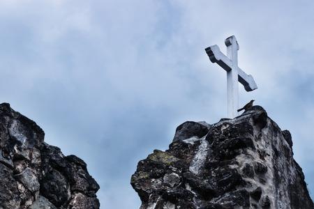 White cross on stone ruins with dramatic blue sky in Hermano Pedro, Antigua, Guatemala Stock Photo - 118920337