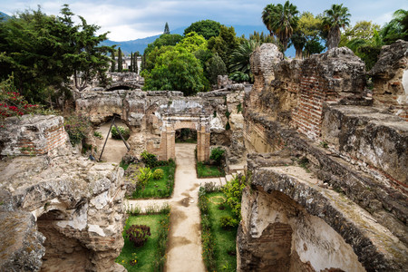 View to ruins in Hermano Pedro with green garden, Antigua, Guatemala Stock Photo - 118920341