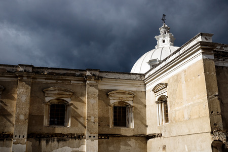 Church of San Fransisco el Grande with sunshine and dramatic cloudscape, Antigua, Guatemala