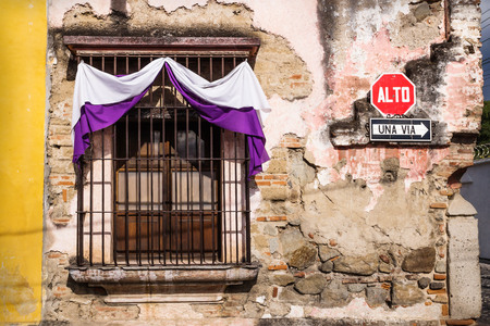 Traditional window with purple white semana santa easter ribbon decoration in Antigua, Guatemala