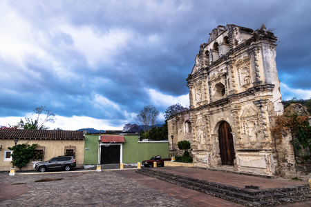 Church fassade ruin of Ermita de Santa Isabel with dramatic blue cloudscape, Antigua, Guatemala Stock Photo