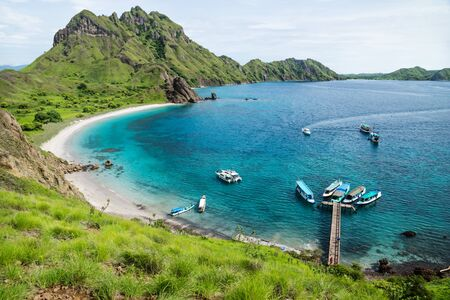 Palau Padar bay with green hills in Komodo National Park, Flores, Indonesia