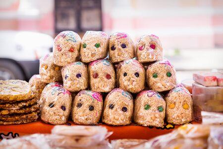 Mexican sugar skull candy with quinoa, calaveras, traditionally used for dias de los muertos, halloween at the market of Merida, Mexico
