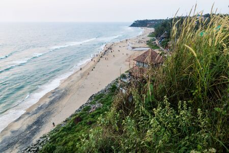 Bird Eyes view from Varkalas sand beach behind grass with along the green cliff, India