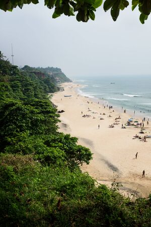 Bird Eyes view from Varkalas sand beach with along the green cliff on a sunny day, India