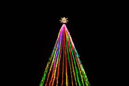 Colorful lights in a Christmas tree with star at the top at Remate de Paseo Montejo, Merida, Yucatan, Mexico