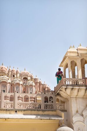 Indian tourist in sari on the tower and wathching on Hawa Mahal, Palace of the Winds, Jaipur, Rajasthan, Inidia