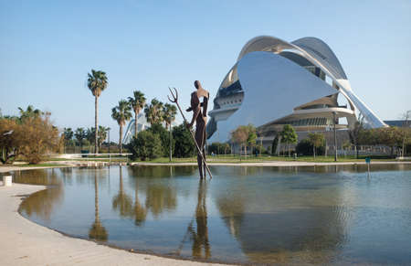 Valencia, Spain - 17 February 2020: Pond at waterman statue Palau des Arts Reina Sofia in the City of Arts and Sciences designed by architects Santiago Calatrava and Felix Candela
