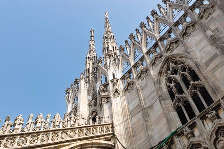 Low angle view of the towers and facade of the Cathedral of Milan on blue sky, Italy Stock Photo