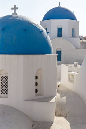 Two traditional Greek blue dome towers with crosses, Oia, Santorini, Greece Stock Photo