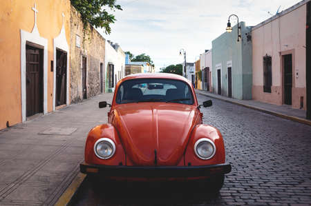 Merica, Yucatan, Mexico - 28 October 2018 - Front of red Oldtimer Volkswagen Beetle in the colonial historical streets at 'Casa Culcal Kin' Editorial