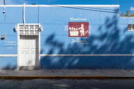 Merica, Yucatan, Mexico - 28 October 2018 Colonial blue building with typical cantina painted text