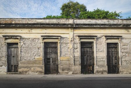Facade of typical Mexican abandoned colonial building in Merida, Yucatan, Mexico