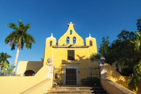 Yellow church with bell tower 'Santa Isabel' in Merida during cloudless sunny day, Yucatan, Mexico