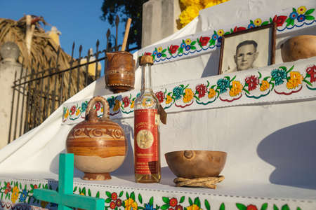 Merida, Mexico - 31 October 2018: Traditional altar for day of the dead, dia de los muertos with Maya terracotta and photo of deceased