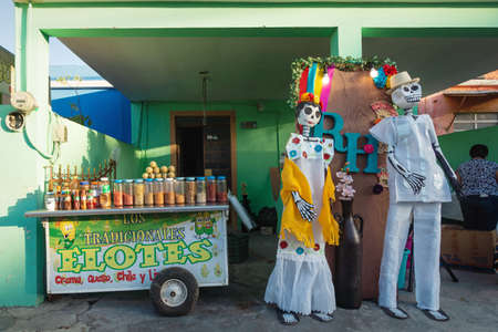 Merida, Mexico - 31 October 2018: Food stand for 'Elotes' which means corn with decoration of Catrina puppets for day of the dead festival