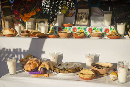 Merida, Mexico - 31 October 2018: Traditional altar for day of the dead, dia de los muertos with food offerings and photos of deceased