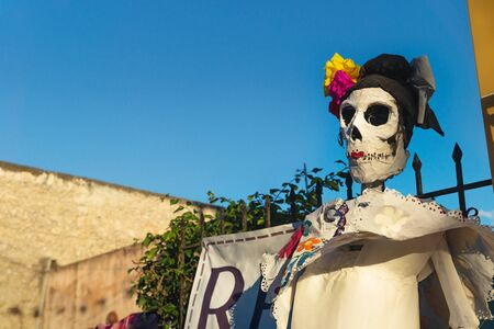 Catrina skull puppet as decoration for celebration of day of the dead 'dia de los muertos', Merida, Yucatan, Mexico