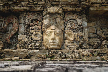 Basrelief carving of Mayan king and signs at the palace of the archaeological site of Palenque, Chiapas, Mexico