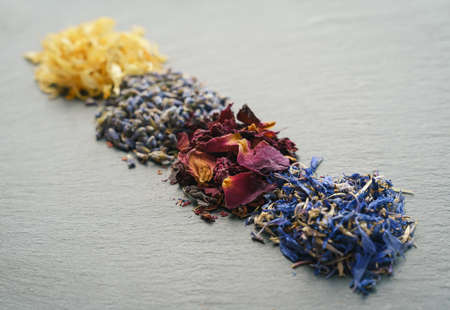 Floral herbs - dried marigold, lavender, rose and cornflower petals as aromatic ingredients for cooking or tea