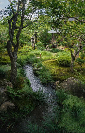 Kyoto, Japan - September 18, 2017: Natural Japanese zen garden Sogenchi with river running in lush forest landscape at temple Tenryu-ji Editorial