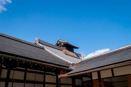 Kyoto, Japan - September 18, 2017: Typical Japanese roof of the temple building Tenryu-ji on blue sky Editorial