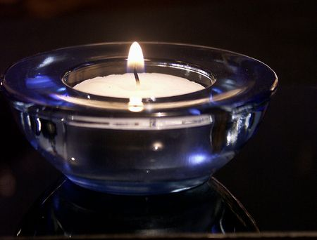 Blue candle with fire on the white background Stock Photo - 974105