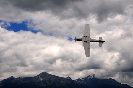 monoplane: Small airplane doing aerial acrobatics at low altitude Stock Photo