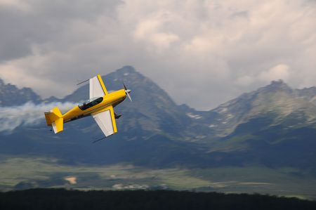 monoplane: erial acrobatics in mountains - weer airplane