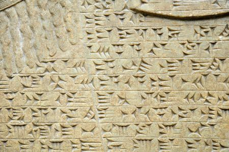 Ancient sumerian cuneiform writing engraved in a stone Stock Photo