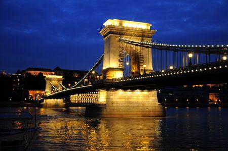 Night view of the illuminated chain bridge in Budapest, Hungary